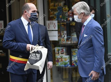 King Philippe of Belgium visits several stores in the centre of Brussels in preparation for the de-confinement of shops