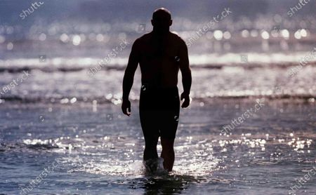 Stock Picture of Keith Wood Feature, Inchedoney, Co. Cork 4/10/1999. Keith Wood relaxes in the sea after training this morning