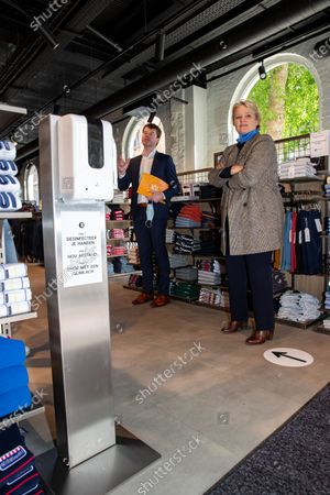 Voka's Bert Mons and Minister Nathalie Muylle pictured during a visit of Minister Muylle to clothes shops Boggie and Brooklyn, in the city center of Roeselare, Monday 11 May 2020. Belgium goes into its ninth week of confinement. Stage 1B of the deconfinement plan in the ongoing corona virus crisis starts. All shops can reopen and more people can return to work.