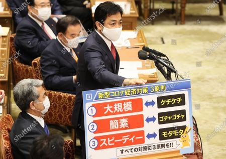 Japanese opposition Democratic Party for the People leader Yuichiro Tamaki wearing a face mask questions to Prime Minister Shinzo Abe at Lower House's budget committee session at the National Diet in Tokyo on Monday, May 11, 2020. The government is expecting to remove a state of emergency at some prefectures in Japan on May 14.
