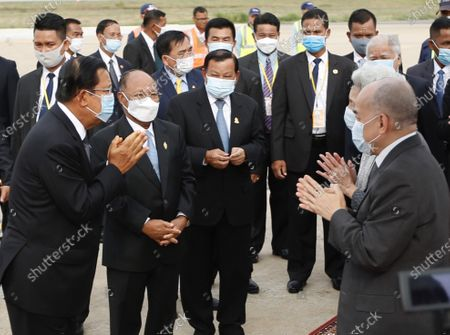 Cambodian King Norodom Sihamoni (2-R) and his mother Queen Norodom Monineath (3-R) arrive at Phnom Penh International Airport in Phnom Penh, Cambodia, 11 May 2020. Cambodian King Norodom Sihamoni and his mother Queen Norodom Monineath came back from a health check-up in China.