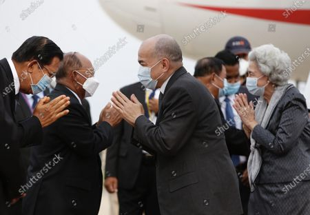 Cambodian King Norodom Sihamoni (C) and his mother Queen Norodom Monineath (R) arrive at Phnom Penh International Airport in Phnom Penh, Cambodia, 11 May 2020. Cambodian King Norodom Sihamoni and his mother Queen Norodom Monineath came back from a health check-up in China.