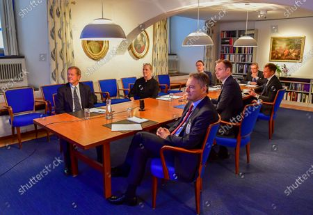 King Carl Gustaf and Prince Daniel during a video conference with representatives of the Swedish business community Cecilia Malmstrom, Anna Stellinger, Carl-Henric Svanberg, Marcus Wallenberg, Leif Johansson, Carl Bennet, Jacob Wallenberg and Fredrik Persson at Stockholm Castle