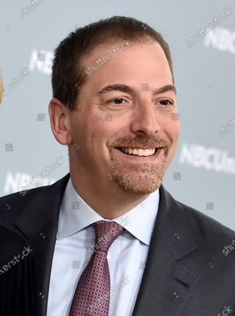 """Chuck Todd at the 2018 NBCUniversal Upfront in New York. NBC News is apologizing for a """"Meet the Press"""" segment that cut a portion of an interview with Attorney General William Barr that left a false impression. That has led to President Donald Trump calling for the network to fire the show moderator Chuck Todd. The show was discussing the Justice Department's decision to drop its case against the president's former national security adviser, Michael Flynn, and referred to a CBS interview where Barr said of the decision that history is written by the winners. Todd criticized Barr for not making the case that he was upholding the law - but, in fact, Barr went on to do that in his complete answer to the CBS reporter"""