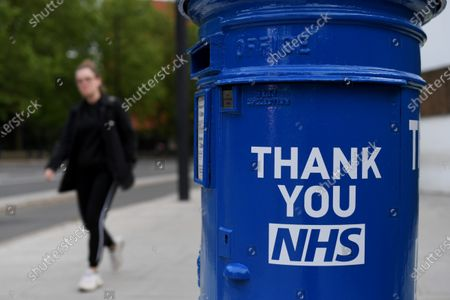 A Royal Mail postbox painted blue in support for the NHS during the Covid-19 outbreak.