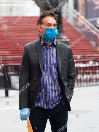 Stock Image of Brian Stokes Mitchell is seen wearing a mask and gloves in Times Square