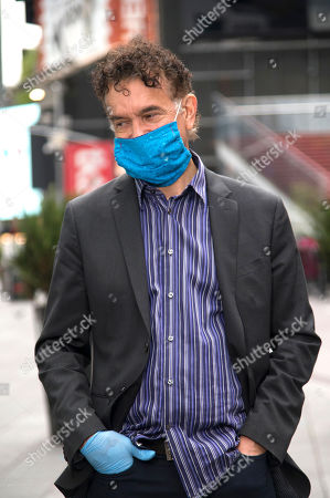 Stock Photo of Brian Stokes Mitchell is seen wearing a mask and gloves in Times Square