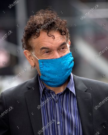 Brian Stokes Mitchell is seen wearing a mask and gloves in Times Square