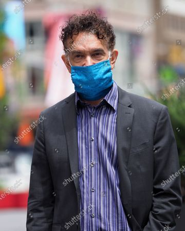 Stock Picture of Brian Stokes Mitchell is seen wearing a mask and gloves in Times Square