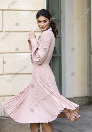Linda Morselli wears a Luisa Beccaria dress during the women's fashion week in February