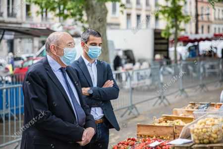 Gerard Collomb (C), and Yann Cucherat (R), candidate for mayor of Lyon in the municipal elections of 2020, during a visit at the reopening of a market in Lyon, on the docks of Saone river, during the 50 th day of lockdowon. Access to the market is limited and the wearing of masks and hand cleaning with hydro-alcoholic gel is obligatory before entering the market. Since March 24, 2020 and following the confinement of the French population, the markets of the city of Lyon have been closed.