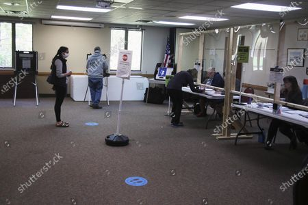 Voters observe social distancing at the United Methodist Church polling place, in Hudson, Wis.in Wisconsin's special congressional election to replace retired Republican reality TV star Sean Duffy, in the 7th District race between Republican Tom Tiffany and Democrat Tricia Zunker