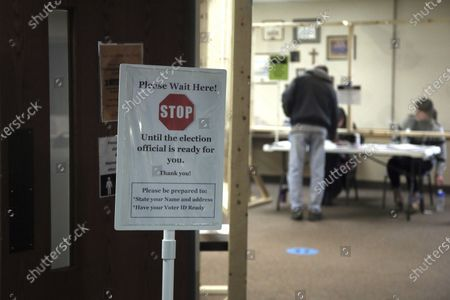 Sign alert voters at the United Methodist Church polling place, in Hudson, Wis.in Wisconsin's special congressional election to replace retired Republican reality TV star Sean Duffy, in the 7th District race between Republican Tom Tiffany and Democrat Tricia Zunker