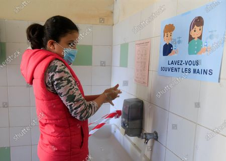 A girl washes her hands at the Simone Veil Primary School in Nice, France, May 12, 2020. Nearly two months after ordering its 67 million population to stay home to stem the coronavirus outbreak, France on Monday cautiously started a gradual process to return to normalcy, easing some restrictions while maintaining others to avoid a new epidemic wave. Some 1.5 million children, or 22 percent of the country's total number of pupils, are preparing to go to school on Tuesday, and 190,000 teachers resumed work on Monday, according to the Education Ministry's data.