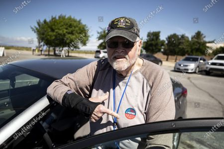 John, 80 year old US army veteran, poses pointing at his 'I Voted' sticker after he casted his ballot at a in-person polling center on the Lancaster National Soccer Center's parking lot during the Congressional 25th District Special General Election amid the coronavirus pandemic in Lancaster, California, USA, 12 May 2020. The election, following Democrat Katie Hill's resignation, opposes Democratic candidate Christy Smith and Republican candidate Mike Garcia. US President Donald Trump accused Democrats of trying to 'steal' these special election in California by adding this polling place in Lancaster, one of the most diverse sections of the district.