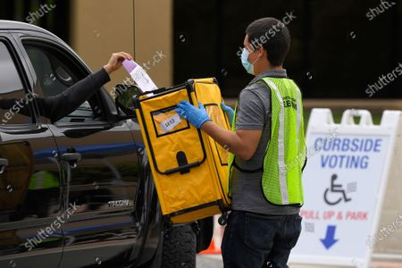 Voters drop off ballots in a special election for California's 25th Congressional District during the coronavirus outbreak, in Simi Valley, Calif. Republican Mike Garcia and Democrat Christy Smith are running for the seat after the resignation of Rep. Katie Hill, D-Calif