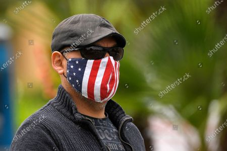 Voter leaves after casting his ballot in a special election for California's 25th Congressional District during the coronavirus outbreak, in Simi Valley, Calif. Republican Mike Garcia and Democrat Christy Smith are running for the seat after the resignation of Rep. Katie Hill, D-Calif