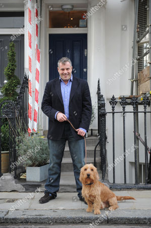 23/10/09 apprentice star james max at two addresses on same road in chelsea with dog barnaby pic david poole.