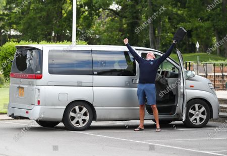 The Club Captain Nick Adams celebrates as he gets out of his car before he takes the first tee off time as The Fulwell Golf Club, West London opens its doors after the lockdown, with strict social distancing measures in place.