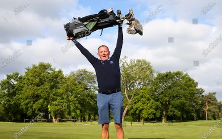 The Club Captain Nick Adams celebrates before takes the first tee off time as The Fulwell Golf Club, West London opens its doors after the lockdown, with strict social distancing measures in place.
