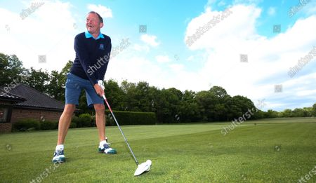 Stock Photo of The Club Captain Nick Adams takes the first tee off time as The Fulwell Golf Club, West London opens its doors after the lockdown, with strict social distancing measures in place.