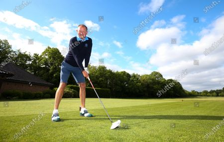 The Club Captain Nick Adams takes the first tee off time as The Fulwell Golf Club, West London opens its doors after the lockdown, with strict social distancing measures in place.