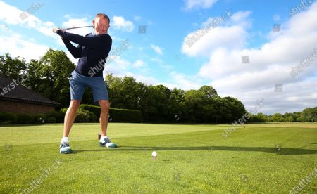 Stock Picture of The Club Captain Nick Adams takes the first tee off time as The Fulwell Golf Club, West London opens its doors after the lockdown, with strict social distancing measures in place.