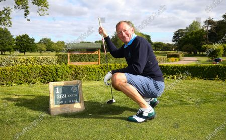 Stock Image of The Club Captain Nick Adams takes the first tee off time as The Fulwell Golf Club, West London opens its doors after the lockdown, with strict social distancing measures in place.