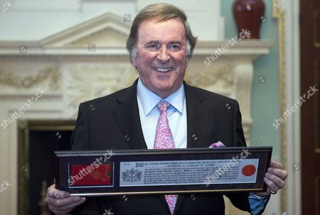Sir Terry Wogan is presented with his Freeman certificate at The Mansion House