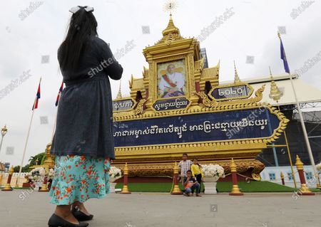 A Cambodian family takes pictures with a huge portrait of Cambodia's King Norodom Sihamoni on display in front of the Royal Palace in Phnom Penh, Cambodia, 13 May 2020. The monarch's birthday celebrations are held from 13 to 15 May.