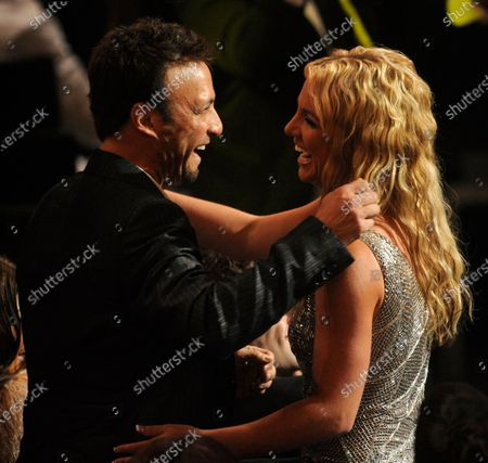 Britney Spears and her manager, Larry Rudolph after she won one of three awards at the 2008 MTV Video Music Awards in Los Angeles.Rudolph, Spears' longtime manager, has worked with hit maker Dr. Luke for years