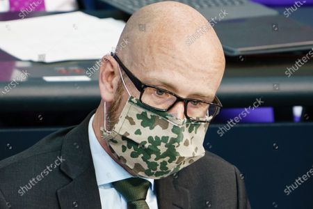 Stock Picture of State secretary at the Defense Ministry Peter Tauber wears a face mask with a camouflage pattern during a Aktuelle Stunde current debate session on working conditions in the meat producing industry at the German parliament 'Bundestag' in Berlin, Germany, 13 May 2020. Workers of slaughterhouses in Germany became infected with the coronavirus due to accommodating conditions without options for social distancing. The German Bundestag discusses cheap wages and working conditions in the meat-processing industry.