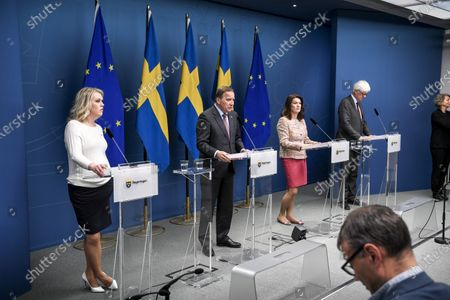 (L-R) Sweden's Health and Social Affairs Minister Lena Hallengren, Prime Minister Stefan Lofven, Foreign Minister Ann Linde and General Director of the Public Health Agency of Sweden Johan Carlson hold a joint press briefing on the current situation of the ongoing pandemic of the COVID-19 disease caused by the SARS-CoV-2 coronavirus in the Scandinavian country, in Stockholm, Sweden, 13 May 2020.