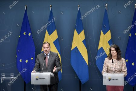 Swedish Prime Minister Stefan Lofven (L) speaks next to Foreign Minister Ann Linde (R) during a press briefing on the current situation of the ongoing pandemic of the COVID-19 disease caused by the SARS-CoV-2 coronavirus in the Scandinavian country, in Stockholm, Sweden, 13 May 2020.