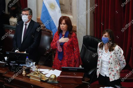 The President of the Argentine Senate, Cristina Fernandez de Kirchner (C), listens to the country's anthem during the first virtual session in the history of said legislative chamber, due to the COVID-19 pandemic, in Buenos Aires, Argentina, 13 May 2020.