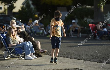 Andrew Summers, 7, dances on the street during musician Adam Chester's weekly neighborhood concert, in the Sherman Oask section of Los Angeles