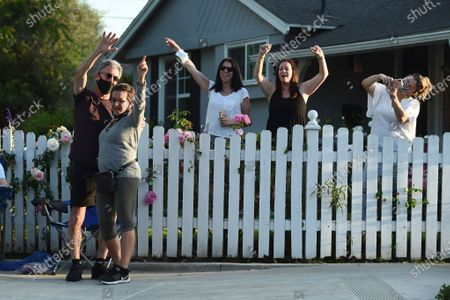 Stock Picture of President Gabrielle Carteris, second from left, and her husband Charles Isaacs, left, are among the spectators at musician Adam Chester's weekly neighborhood performance, in the Sherman Oaks section of Los Angeles