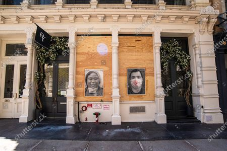 Street Art displayed outside David Yurman storefront temporarily closed in Soho during the coronavirus pandemic outbreak