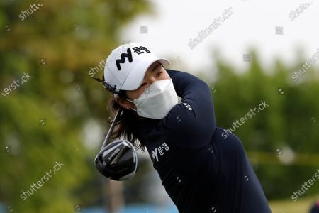 Cho Jeong-min of South Korea watches her tee shot on the 10th hole during the first round of the KLPGA Championship at the Lakewood Country Club in Yangju, South Korea