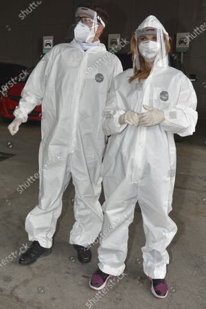 Actress Mariana Seoane and Actor Julio Camejo wear protective suit while delivery medical supplies at Cuajimalpa Hospital to support to health workers during the Coronavirus (COVID-19) pandemic.