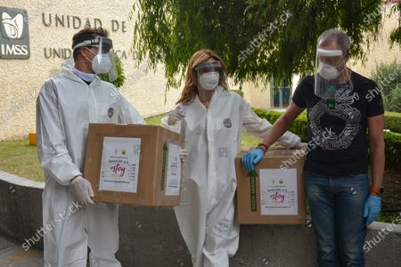 Stock Photo of Actress Mariana Seoane and Actor Julio Camejo wear protective suit while delivery medical supplies at Cuajimalpa Hospital to support to health workers during the Coronavirus (COVID-19) pandemic.
