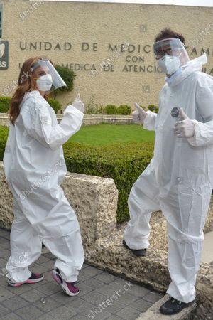 Stock Picture of Actress Mariana Seoane and Actor Julio Camejo wear protective suit while delivery medical supplies at Cuajimalpa Hospital to support to health workers during the Coronavirus (COVID-19) pandemic.