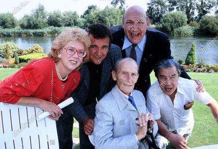 L -R Anna Karen, Tony Selby, Peter Cushing, Bernard Bresslaw and Burt Kwouk c.1989