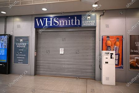 A closed WH Smith at a station in London, Britain, 14 May 2020. High street retailer WH Smith has reported that its sales fell significantly under the lockdown. British Chancellor Sunak said it is very likely that the UK is facing a 'significant recession,' reports state. The economy contracted at the fastest pace since the financial crisis in 2008 and shrank by 2 percent in the first three months of 2020, as the ongoing pandemic of the COVID-19 disease caused by the SARS-CoV-2 coronavirus forced the country into lockdown.