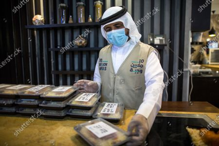 A volunteers prepares meals to be given to people during the Muslims holy month of Ramadan in Dubai, United Arab Emirates, 14 May 2020. Sheikh Mohammed Bin Rashid Al-Maktoum, the ruler of Dubai, launched an initiative to distribute ten million meals or food parcels to support vulnerable individuals and families affected by the ongoing pandemic of the Covid-19 disease.