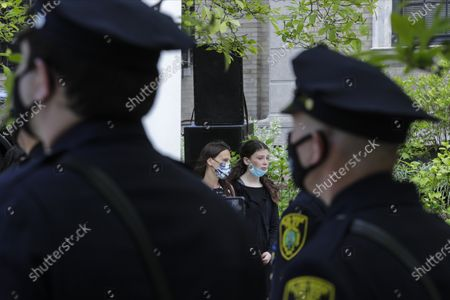 Stock Picture of Natalie Roberts, right, daughter of Glen Ridge Police Officer Charles Roberts, reacts with her mother Alice Roberts, left, during a memorial service for, Glen Ridge, N.J. Roberts died of complications related to COVID-19