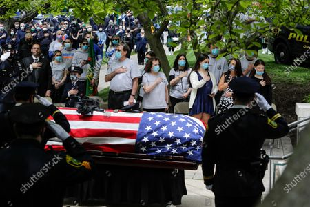 Natalie Roberts, right, and her mother Alice Roberts, second from right, react with loved ones during a memorial service for Glen Ridge Police Officer Charles Roberts, Glen Ridge, N.J. Roberts died of complications related to COVID-19