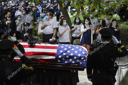Stock Photo of Natalie Roberts, right, and her mother Alice Roberts, second from right, react with loved ones during a memorial service for Glen Ridge Police Officer Charles Roberts, Glen Ridge, N.J. Roberts died of complications related to COVID-19
