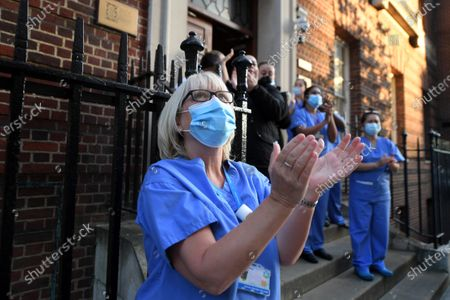 Medical staff from St Mary's Hospital in Paddington, London, take part in the Clap For Our Carers, the weekly appreciation for those working on the frontline of healthcare during the Covid-19 outbreak.