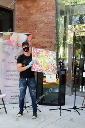 Stock Image of World-renowned magician and headliner Criss Angel provides $250,000 worth of donations to 100 families being treated at Cure 4 the Kids Foundation